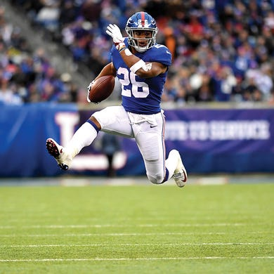 New York Giants running back Saquon Barkley (26) rushes against the Tampa  Bay Buccaneers befba9f72