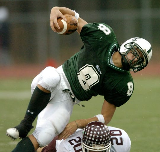 Gianluca Ragone (8) of Ramapo is upended by Pete DeCicco of Wayne Hills late in the second quarter of a North 1, Group 3 football semifinal on Nov. 20, 2004. Photo by Christopher Gottlieb.
