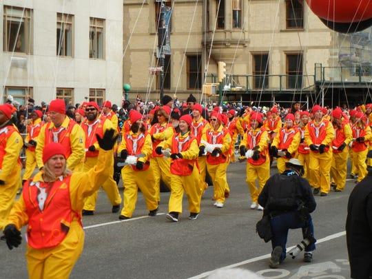 Ronald McDonald balloon handlers at the Macy's Thanksgiving Day parade, 2016.