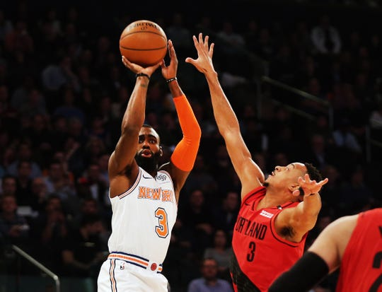 Nov 20, 2018; New York, NY, USA; New York Knicks guard Tim Hardaway Jr. (3) shoots against Portland Trail Blazers guard CJ McCollum (3) during the first half at Madison Square Garden.