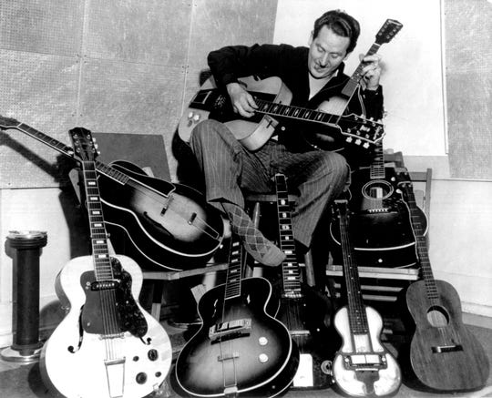 Les Paul with guitars.
