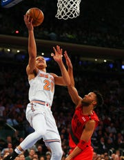 Nov 20, 2018; New York, NY, USA; New York Knicks forward Kevin Knox (20) shoots against Portland Trail Blazers guard Evan Turner (1) during the first half at Madison Square Garden.
