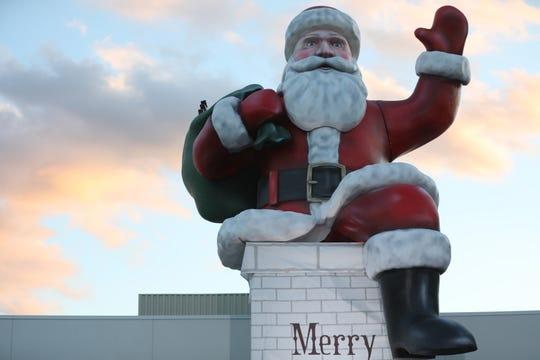 The sun sets behind Big Santa at the Garden State Plaza Mall in Paramus, Monday, November 20, 2018.