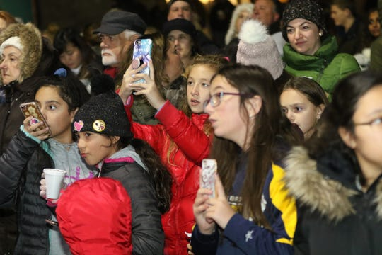 People await the arrival of Santa in Paramus on Tuesday, November 20, 2018.