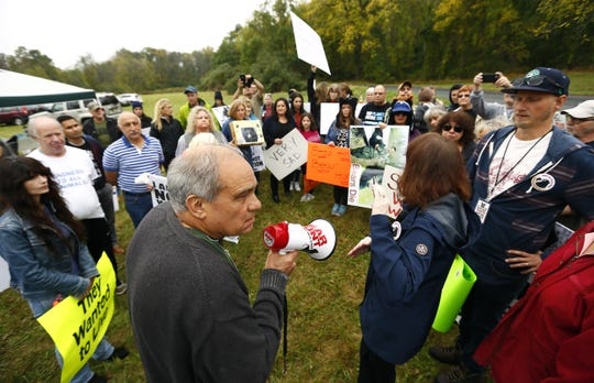 Protester Bill Crain of Poughquag, NY talks to fellow protesters before he was arrested for knowingly trespassing past a designated protest area during the annual six-day, state-sanctioned  bear hunt, designed to help control the growing bear population in northwestern New Jersey. More than 50 protesters gathered at a grassy area off Fredon Springdale Road. October 14, 2017. Fredon, New Jersey