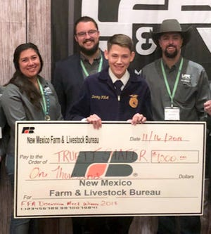 From left are Young Farmers and Ranchers committee members Nicki Jacobs and Jeff Mayberry; winner Truett Shafer, and YF&R committee member Keith Shafer (no relation).