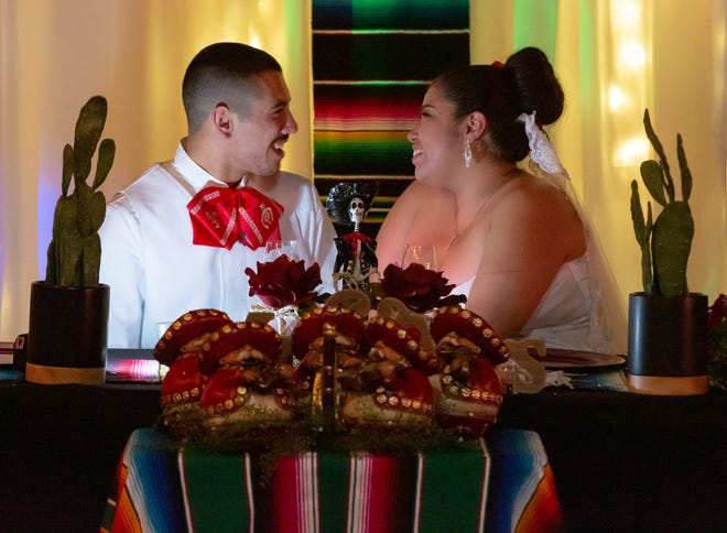 Newlyweds Maria Guadalupe Carrillo and Jacobo Martos share a moment together on Saturday, Nov. 17, 2018, during their wedding reception. The wedding was themed Día de los Muertos in honor of Maria's daughter, Isabella Marie Lerma, who passed away when she was 2 months old.