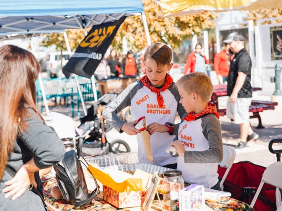 "Wyatt Sowards and Chase Sowards serve up a baked item at their ""Baking Brothers"" booth on Saturday, Nov. 17, 2018 at the Cruces Kids Can Business Showcase."
