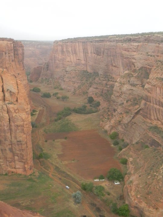 Long and deep, Canyon de Chelly is home to Navajo families who farm in the canyon bottom.