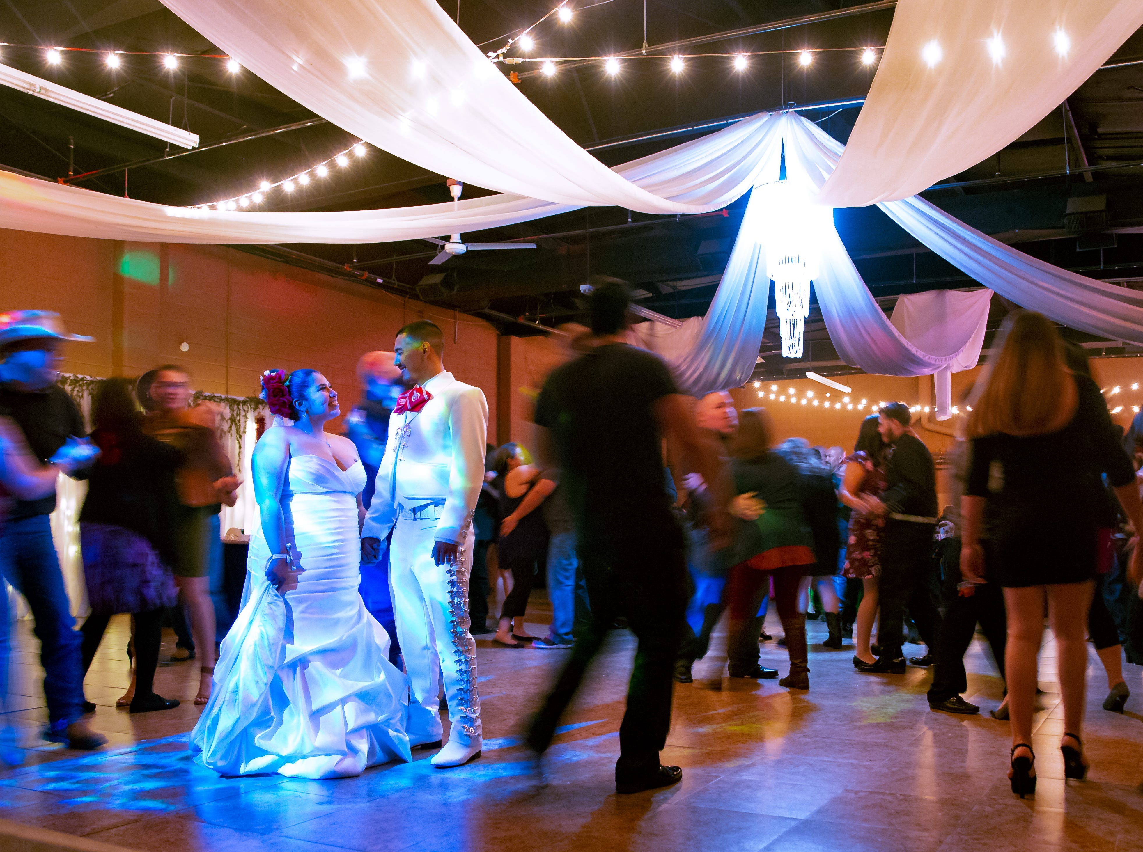 Newlyweds Maria Guadalupe Carrillo and Jacobo Martos share a moment together on the dance  on Saturday, Nov. 17, 2018, during their wedding reception. The wedding was themed Día de los Muertos in honor of Maria's daughter, Isabella Marie Lerma, who passed away when she was 2 months old.