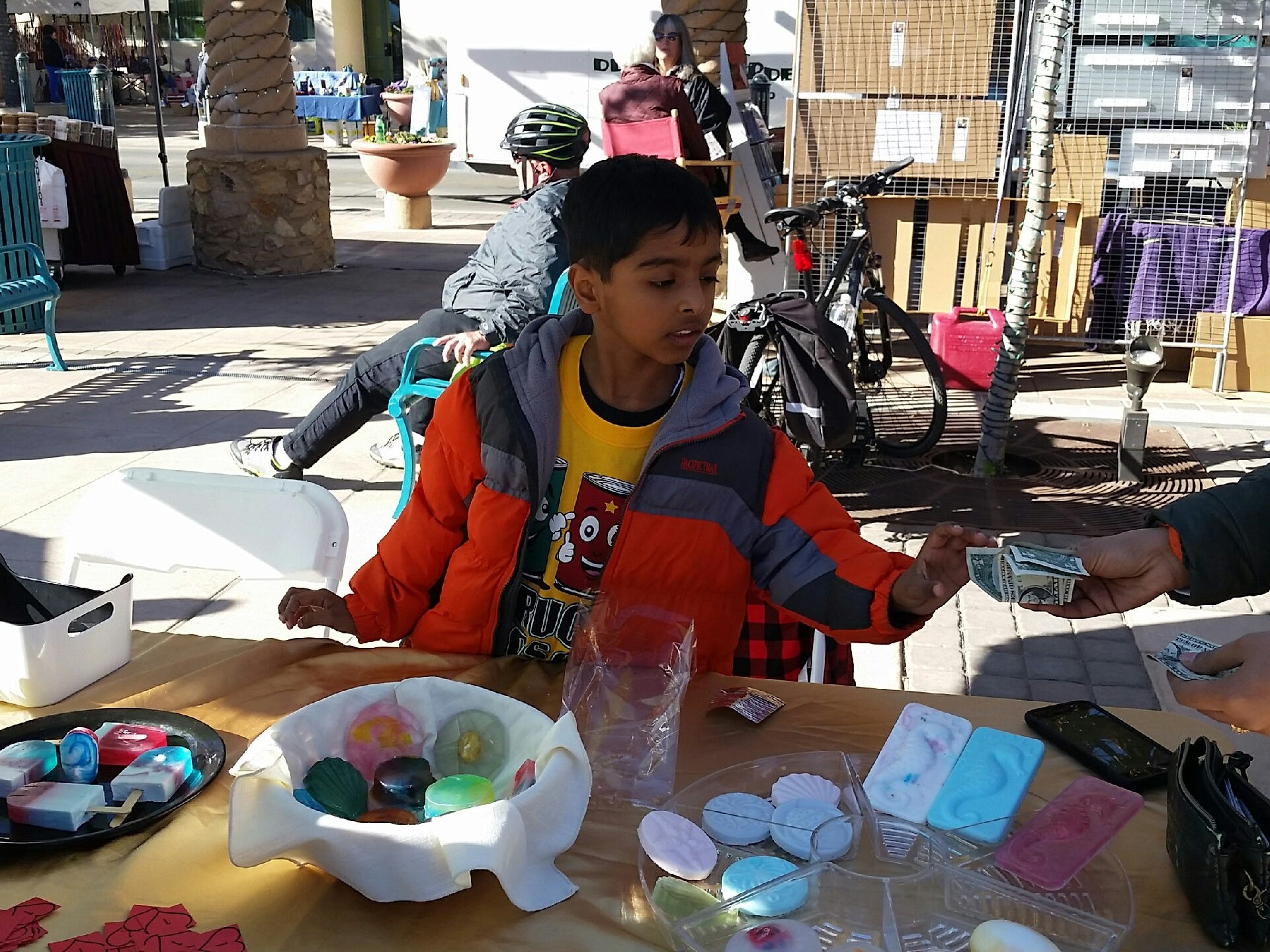 Anay Pahwa sells colorful homemade soaps on Saturday, Nov. 17, 2018 at the Cruces Kids Can Business Showcase at Plaza de Las Cruces.