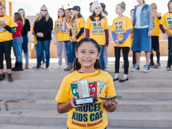 "Arian Gonzales receives first place in the ages 10-12 category for her business, ""Arian's Snack Shack."" She was among dozens of students participating in the Cruces Kids Can Business Showcase on Saturday, Nov. 17, 2018 in downtown Las Cruces."