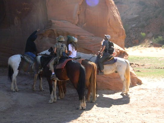 .One of the best ways to see Canyon de Chelly in on horseback. Here the Navajo guide explains the significance of petroglyphs.