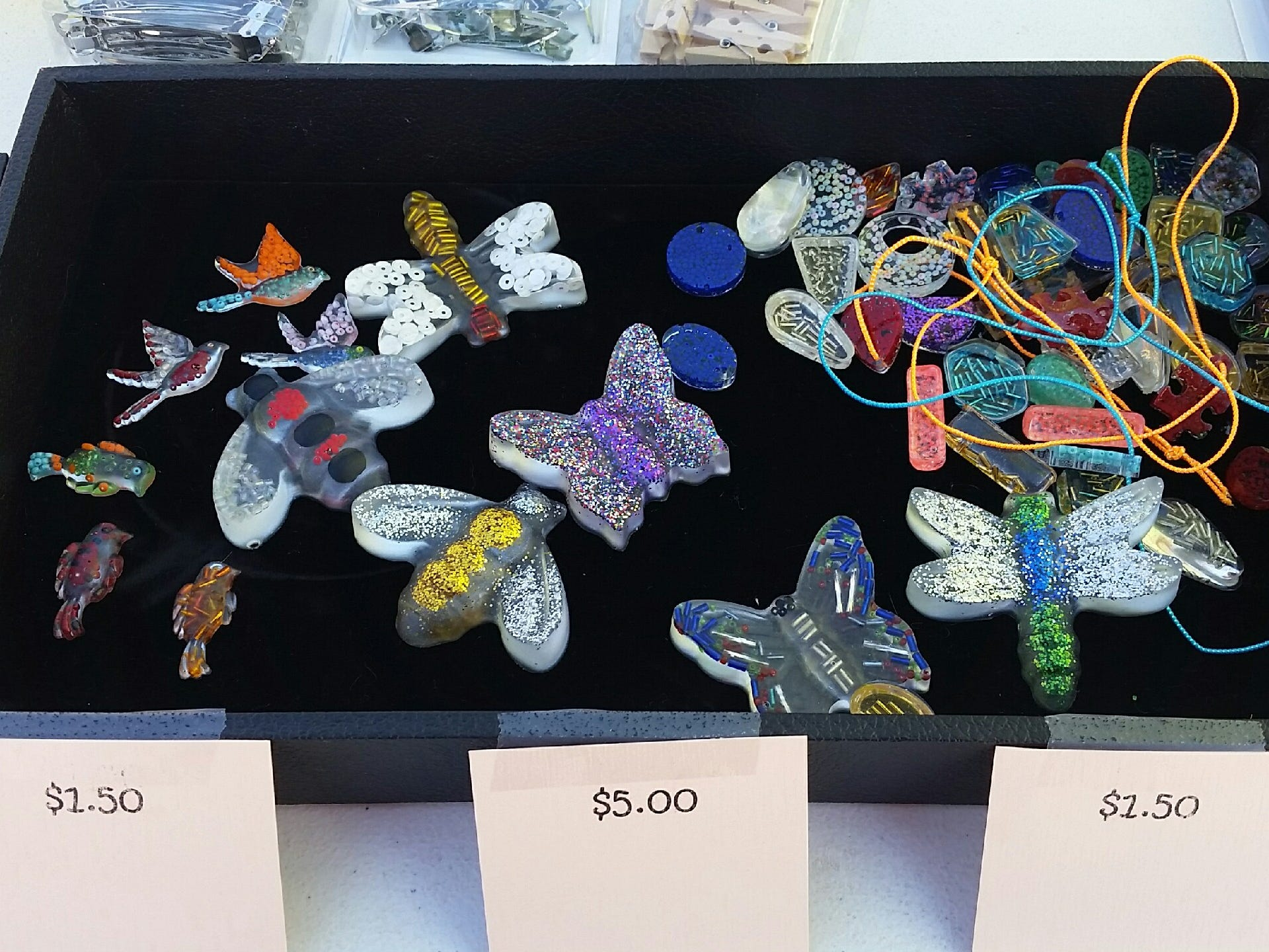Resin jewelry and figurines created by Zachary Beasley are seen Saturday, Nov. 17, 2018 during the Cruces Kids Can Business Showcase.