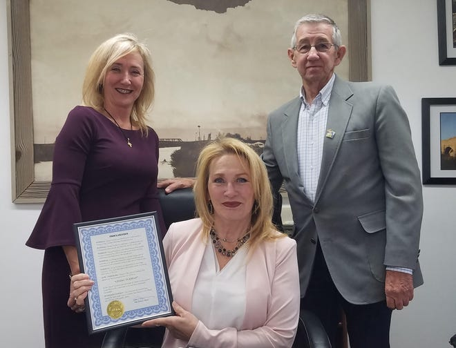 Carlsbad Mayor Dale Janway pronounced Nov. 27 Day of Giving in Carlsbad. Also pictured are Jeannie Watson and Jody Knox.