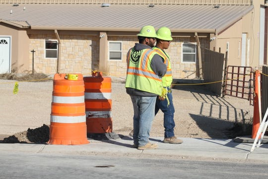 Crews from Constructors Inc. remove barricades from Standpipe Road on Nov. 21, 2018.