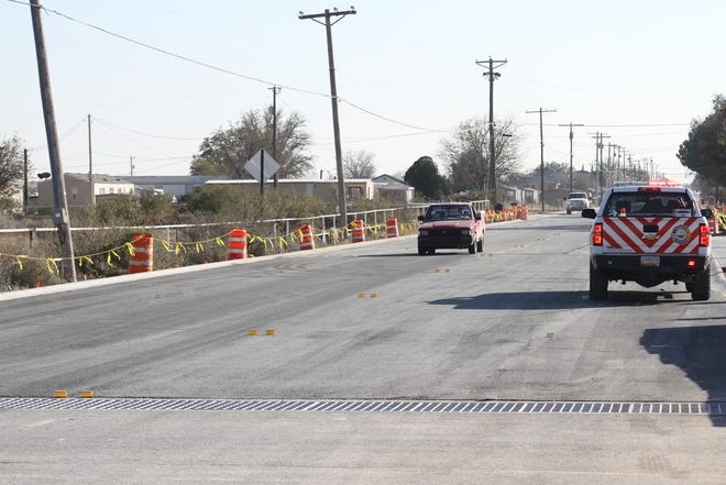 Cars pass drive over the Hackberry Bridge on Nov. 21, 2018. Standpipe Road has reopened.
