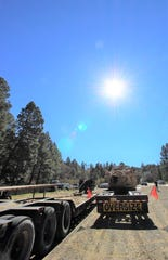 Loaded on Jeff Harvey's tractor trailer, the pieces stay one more day in Ruidoso before route to their destination.