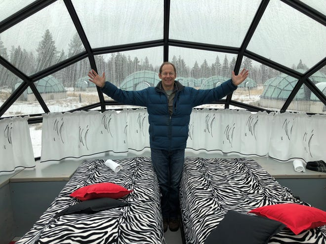 South Lyon's Ed McKenna can't quite believe he is standing inside a glass igloo in northern Finland, waiting for night and the chance to look up at the northern lights.
