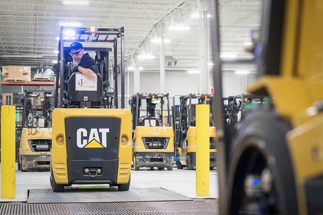 An employee drives a Caterpillar forklift at Fraza.