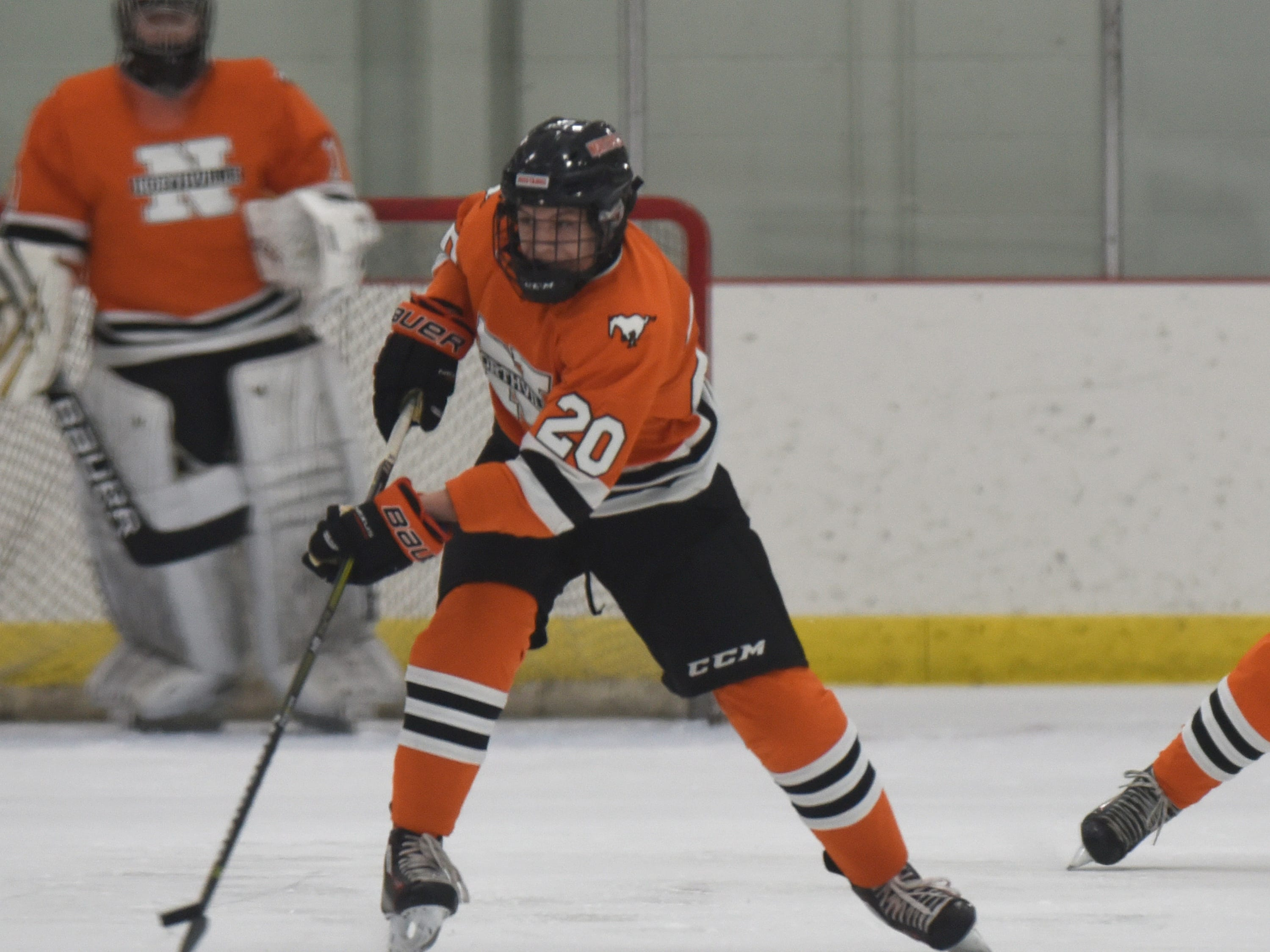 Northville forward Nick McInchak (20) during a KLAA West match up against Novi played at Novi Ice Arena Nov. 20, 2018.