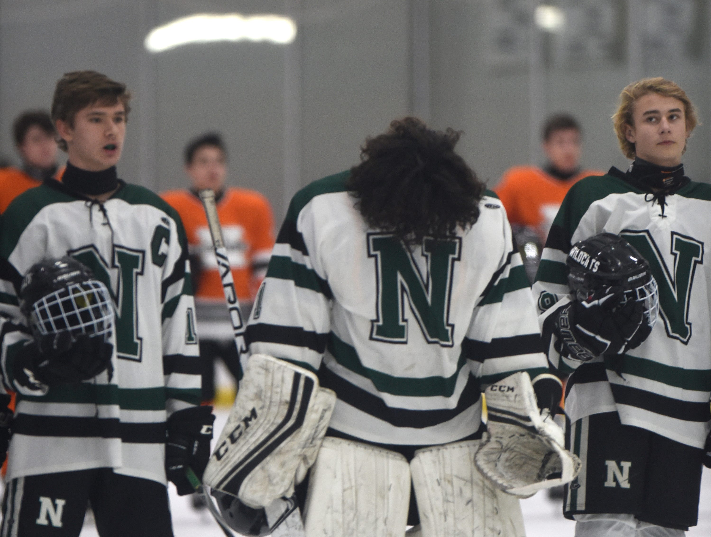 Novi Goalie Evan Budd (1) during the national anthem before a KLAA West match up against Northville played at Novi Ice Arena Nov. 20, 2018.