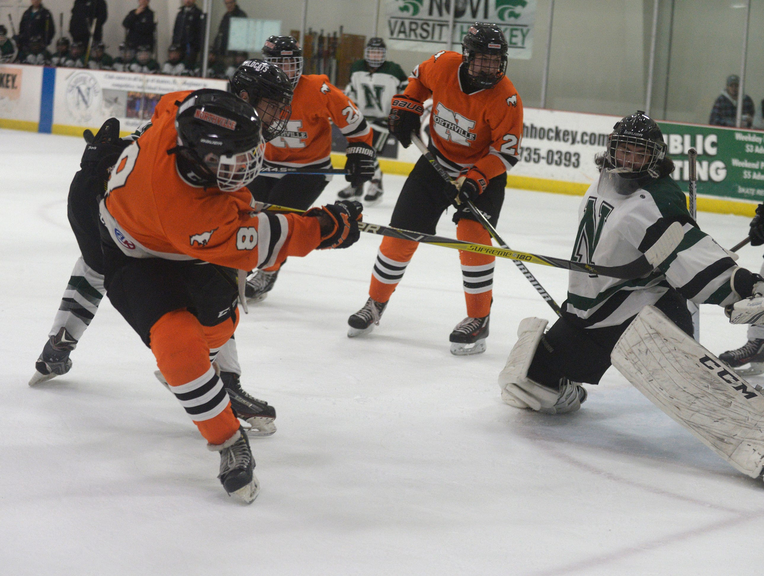 Northville forward Spencer Ziparo (8)  shoots wide of Novi Goalie Evan Budd (1) during a KLAA West match up between the rivals.