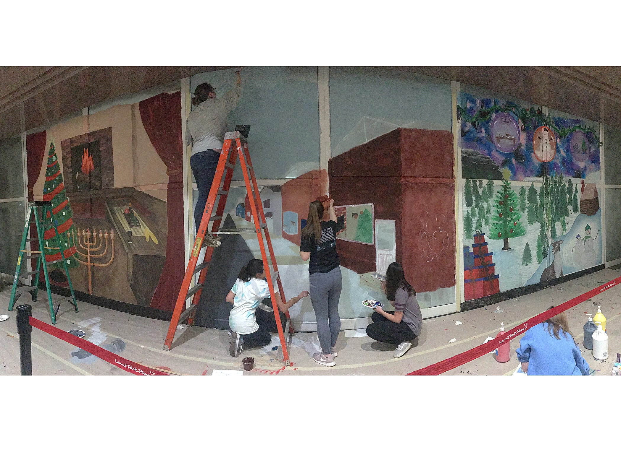 The mural is painted on the glass doors at the mall entrance of the former Carson's. Art students from all three Livonia high schools, Churchill, Stevenson, and Franklin, contributed their skills to the project.