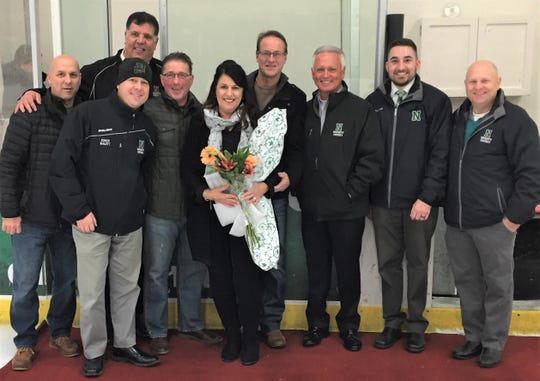 Following the first period longtime Novi team manager Donna Malott was honored after serving 20 years. On hand for the ceremony were (front row, from left) John Smith, Travis Malott, Donna Malott, Jim Lewis, Dan Szalaga, Scott Wolter; (back row, from left) Mark Vellucci and Dave Zarem.