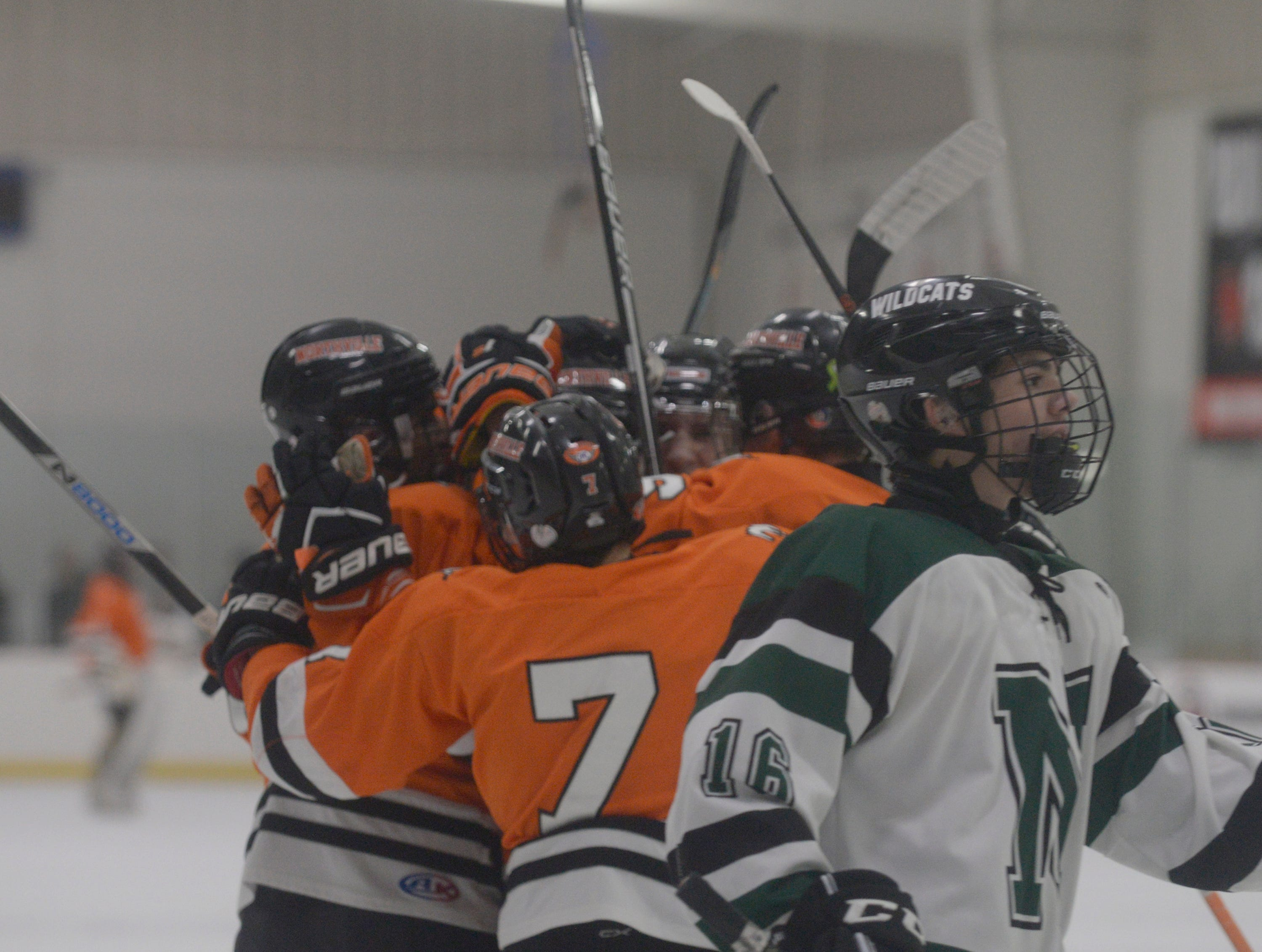 Northville players celebrate first period goal during a KLAA West match up against rival Novi.