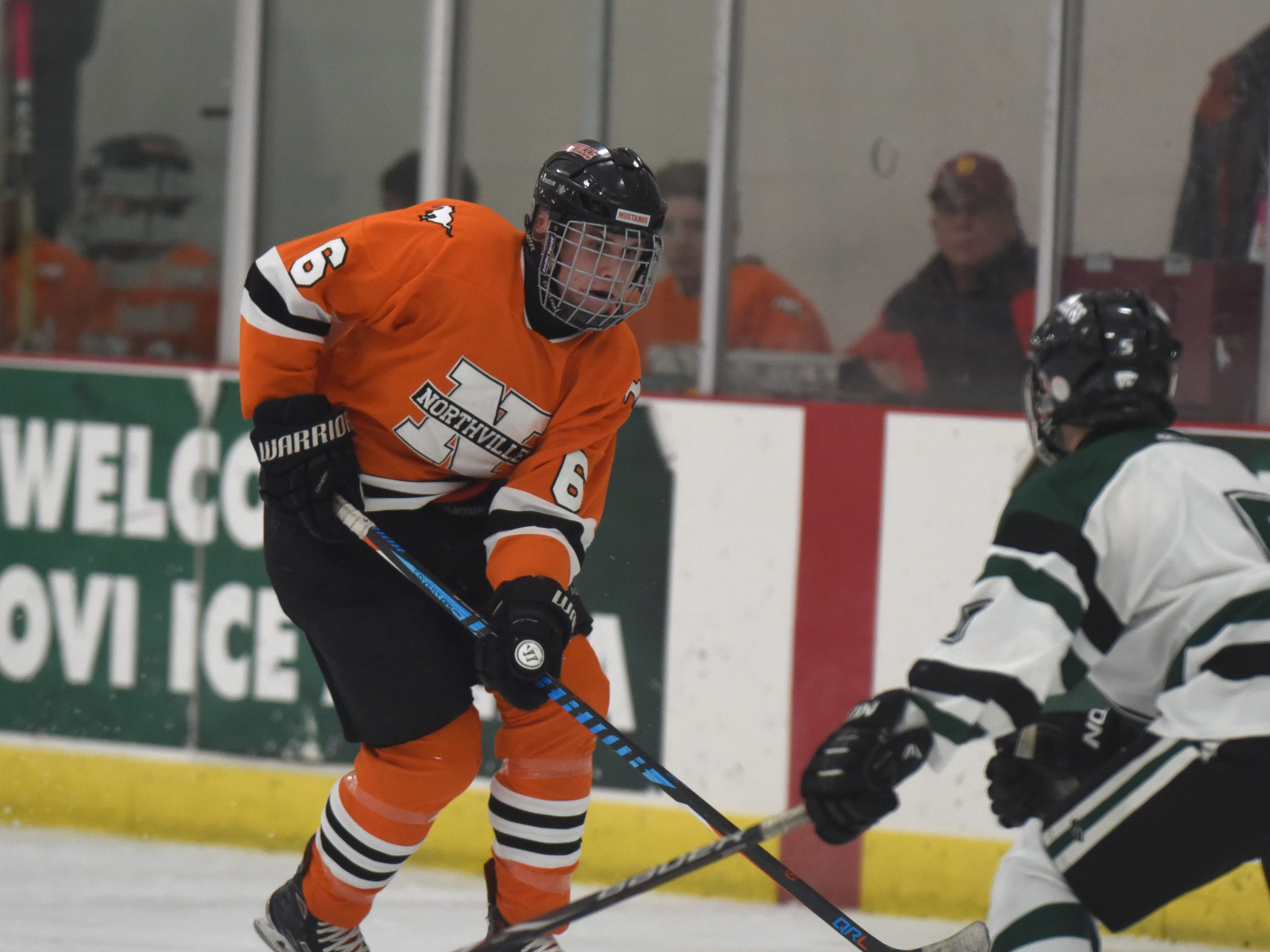 A Northville player moves the puck up ice during a KLAA West match up against Novi on Nov. 20, 2018.