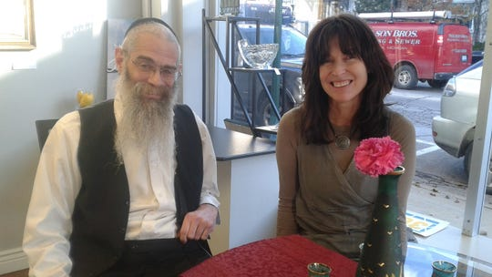 Rabbi Boruch Cohen and his wife, Ita Leah Cohen, sit in the storefront at 36 Mystics