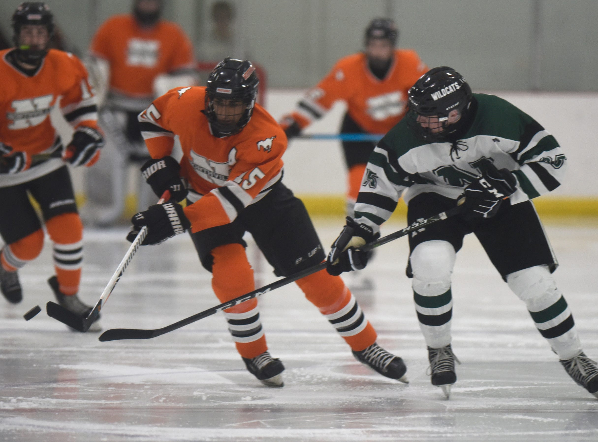 Northville forward Rohan Barad (15) and Novi forward Louis Wolff (23) during a KLAA West match up between rivals Novi and Northville played at Novi Ice Arena Nov. 20, 2018.