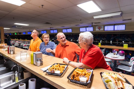 Bowlers Jim Lehr (left), Jeanne Gebbia, Byl Kroening, and Wendy Ridgley at the expanded snack bar