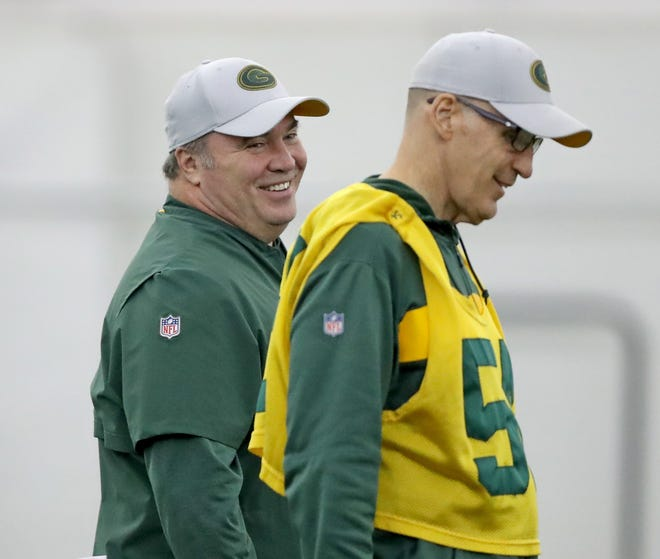Green Bay Packers head coach Mike McCarthy laughs as he talks with Joe Philbin during practice Wednesday, November 21, 2018 inside the Don Hutson Center in Ashwaubenon, Wis.