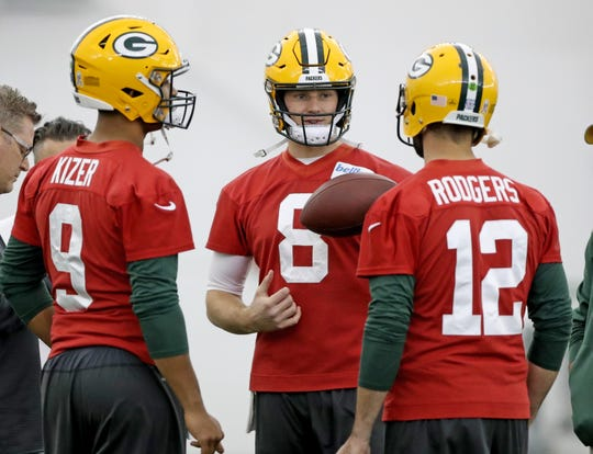 Green Bay Packers quarterback Tim Boyle (8) listens to quarterback Aaron Rodgers (12) during practice Wednesday, November 21, 2018 inside the Don Hutson Center in Ashwaubenon, Wis.