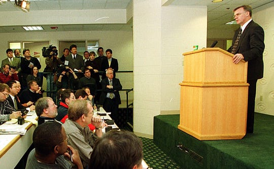 Cliff Christl (seated at the far end of the back row) listens as former Packers head coach Mike Sherman speaks at a news conference in 2000 at Lambeau Field. Christl was an award-winning sportswriter whose career spanned more than 35 years with the Milwaukee Journal Sentinel and the Green Bay Press-Gazette, primarily covering the Packers as a beat writer and columnist.