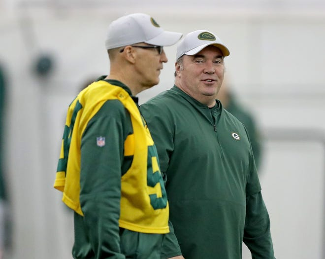 Green Bay Packers head coach Mike McCarthy talks with offensive coordinator Joe Philbin during practice Wednesday, November 21, 2018 inside the Don Hutson Center in Ashwaubenon, Wis.