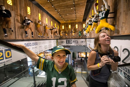 Landon Carr and his mother Courtney visit the second floor of the Packers Hall of Fame museum inside Lambeau Field in 2015. Cliff Christl said one of his first tasks as the Packers team historian was to write all the historical text for the second floor of the Hall. He is currently working on a 10-part documentary on the team's history and a 100th anniversary book.