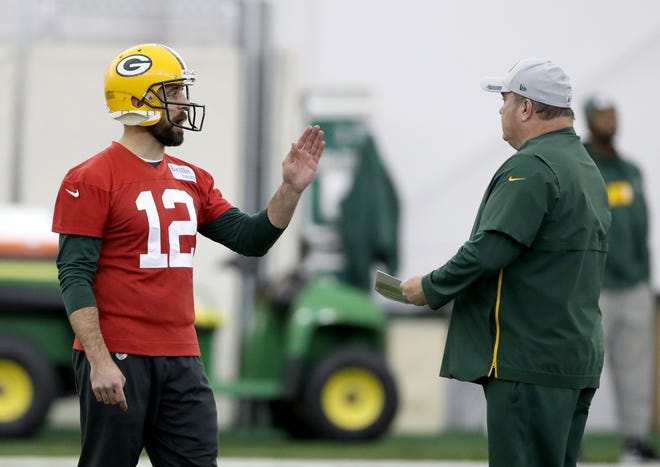Green Bay Packers quarterback Aaron Rodgers (12) and head coach Mike McCarthy talk during practice Wednesday, November 21, 2018 inside the Don Hutson Center in Ashwaubenon, Wis.