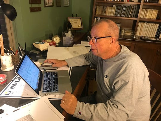Cliff Christl, the Packers team historian, works in his home office in Green Bay.
