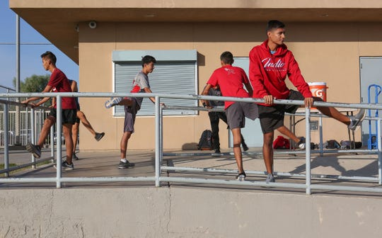 Members of the Indio High School cross country team stretch before a run, November 21, 2018.