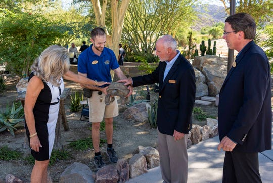 Indian Wells Mayor, Kimberly Muzik, and Palm Desert Mayor Sabby Jonathan, get introduced to Hercules, the desert tortoise.