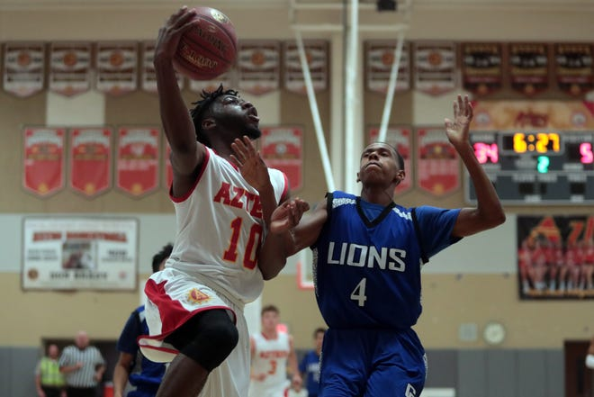Palm Desert's Sam Ogwuche goes for the basket as Cathedral City tries to block on Tuesday, November 20, 2018 in Palm Desert.