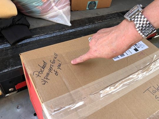 A box packed with donated goods is loaded until a U-Haul heading to Paradise, Calif.