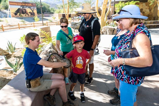Zoo Guests interact with Animal Care Keeper, Christine Johnston, and Jula, the Dumeril's ground boa.