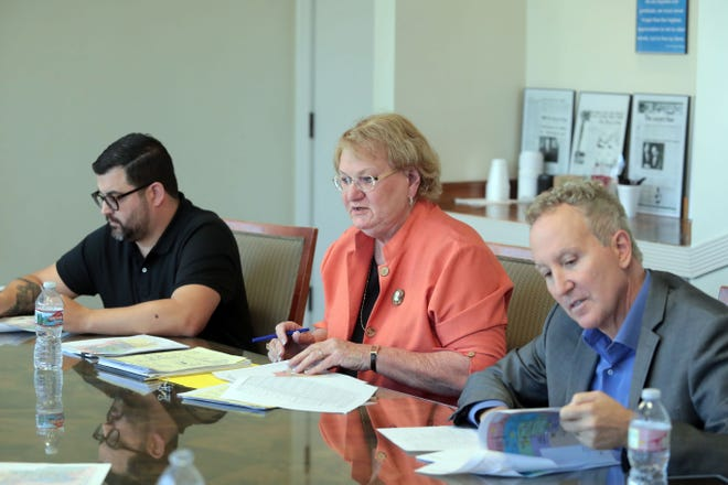 Palm Springs City Council members Geoff Kors, right, and Lisa Middleton, center, along with City Clerk Anthony Mejia, talk to The Desert Sun Editorial Board on Tuesday, November 20, 2018, about the district elections process and the proposed map Middleton created that spurred a firestorm of criticism.