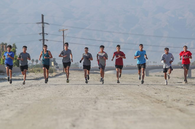 The Indio High School cross country team trains for the state championships, November 21, 2018.