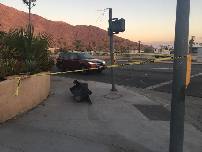 A damaged traffic signal is visible at Ramon Road and Calle Encilia in Palm Springs. A police chase that began in Cathedral City early Wednesday ended with a collision at the Palm Springs intersection. Two suspects were arrested.