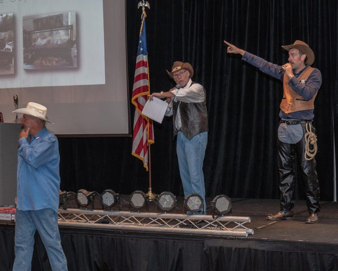 YMCA CEO Rod Ballew, MC Sabby Jonathan and auctioneer Adam Voss working the crowd during the live auction.